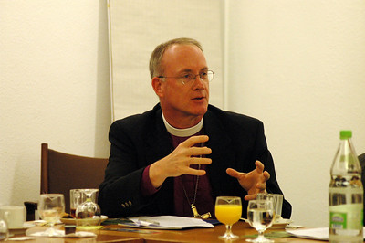 Bishop Michael Burke, ELCA Southeastern Iowa Synod, asks a qustions during a Feb. 15 meeting of the ELCA delegation and WCC officials in Geneva.