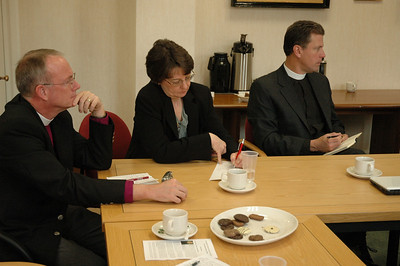 Taking notes during the ELCA delegation's Feb. 5 meeting with officials of The Church of England are, from left, Bishop Michael Burk, ELCA Southeastern Iowa Synod; Mitzi Budde, Virginia Theological Seminary, Alexandria, and Lutheran co-chair, Lutheran-Episcopal Coordinating Committee; and Pastor Steven Loy, Las Cruces, N.M., a member of the ELCA Church Council.