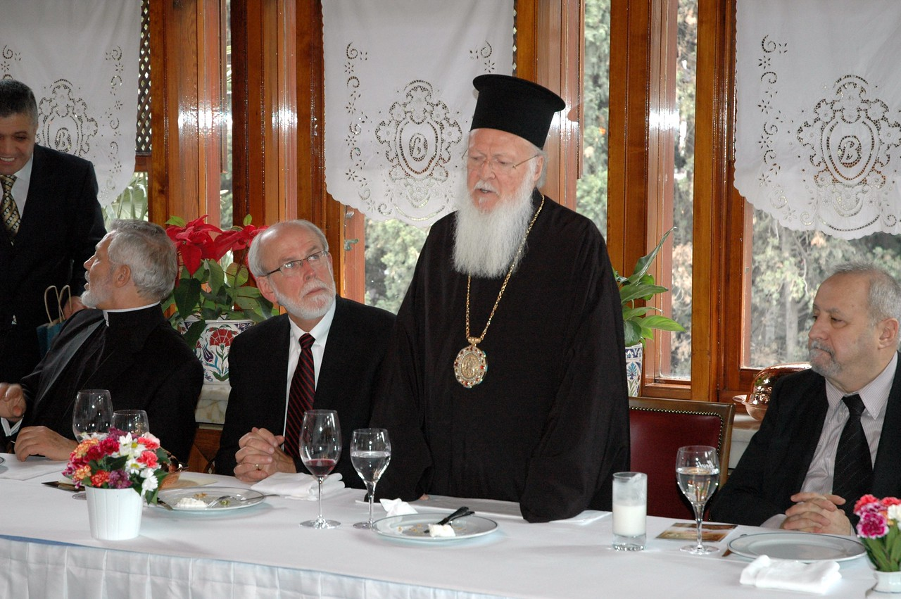 The Ecumenical Patriarch Bartholomew I, world Orthodox leader, addresses the ELCA delegation at a farewell lunheon Feb. 9 in Istanbul.  ELCA Presiding and LWF President Bishop Mark Hanson, to the patriarch's right, looks on.