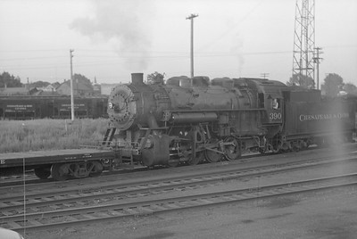 2018.15.N85.6381--ed wilkommen 6x9 neg--C&O--steam locomotive 0-8-0 390 switching cars--Ludington MI--1949 0620