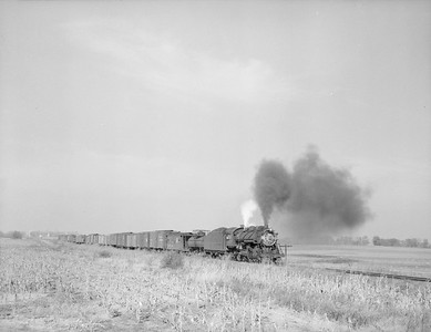 2018.15.N99D.7891--ed wilkommen 3x4 neg--B&O--steam locomotive 2-8-0 2831 on freight train action--location unknown--no date