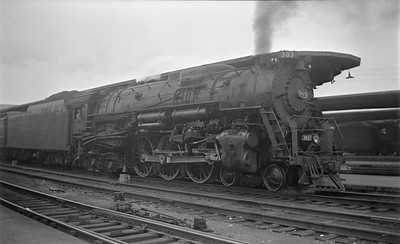 2018.15.N85.6379--ed wilkommen 116 neg--C&O--steam locomotive 4-6-4 303 at passenger station platform--Cincinatti OH--1951 0600