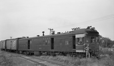 2018.15.N69.5522C--ed wilkommen 116 neg--CB&Q--diesel-electric motorcar 9735 with freight train--near Macomb IL--c1950s 0000