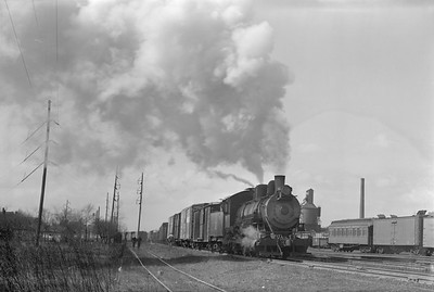 2018.15.N69.5535--ed wilkommen 6x9 neg--CB&Q--steam locomotive 0-6-0 G-10 582 switching freight cars action--Clinton IA--no date
