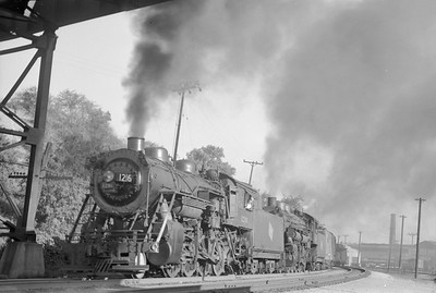 2018.15.N68F.4947--ed wilkommen 6x9 neg--CMStP&P--steam locomotive 2-8-0 C5a 1216 and 2-8-2 L2 686 doublehead North Milwaukee bound freight train action--Milwaukee WI--1948 0700