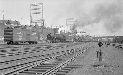 2018.15.N68F.4967--ed wilkommen 116 neg--CMStP&P--steam locomotive 4-8-4 231 and 217 doubleheading on freight 83 action--Milwaukee WI (shops)--no date