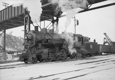2018.15.N68F.4961--ed wilkommen 6x9 neg--CMStP&P--steam locomotive 2-6-2 K1as 912 in yard--Milwaukee WI--no date