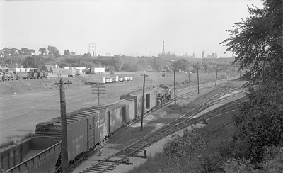 2018.15.N68F.4948--ed wilkommen 116 neg--CMStP&P--steam locomotive 2-6-2 K1as 903 on Wauwatosa patrol freight train near Grand Ave action--Milwaukee WI--1955 0900