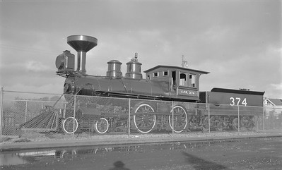 2018.15.N83.6330--ed wilkommen 116 neg--CP--steam locomotive 4-4-0 374 on display--Vancouver BC--1952 0700