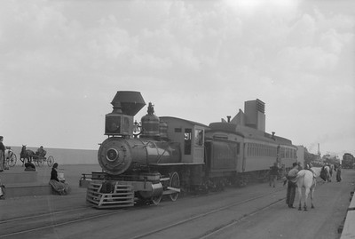 2018.15.N54.6909--ed wilkommen 6x9 neg--Chicago Railroad Fair--AT&SF 0-4-0 5 and passenger cars--Chicago IL--1949 0000