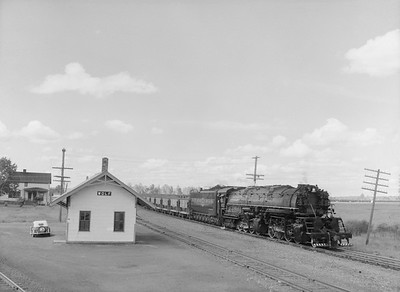 2018.15.N76.7914--ed wilkommen 3X4 neg--DM&IR--steam locomotive 2-8-8-4 M3 222 on train of ore loads pass depot--Wolf MN--1960 0700