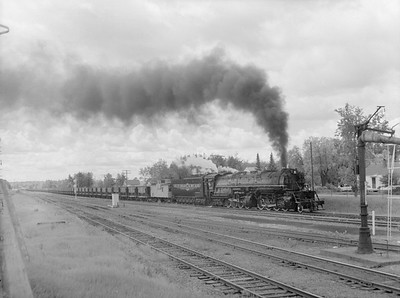 2018.15.N76.7906--ed wilkommen 3X4 neg--DM&IR--steam locomotive 2-8-8-4 M3 222 on train of ore empties--location unknown--1960 0700