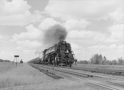 2018.15.N76.7913--ed wilkommen 3X4 neg--DM&IR--steam locomotive 2-8-8-4 M3 222 on train of ore loads--location unknown--1960 0700