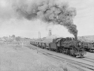 2018.15.N76.7893--ed wilkommen 3X4 neg--DM&IR--steam locomotive 2-8-0 K 1218 switching ore cars in yard action--Ely MN--no date