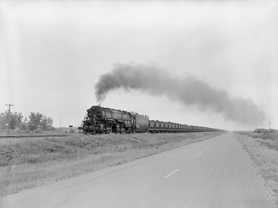 2018.15.N76.7895--ed wilkommen 3X4 neg--DM&IR--steam locomotive 2-8-8-4 M4 234 with train of ore loads southbound action--near Zim MN--1955 0809