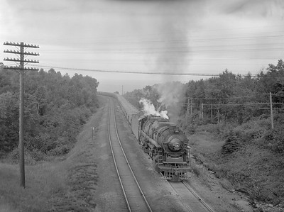 2018.15.N76.7901--ed wilkommen 3X4 neg--DM&IR--steam locomotive 2-10-4 E4 701 with train of ore empties action--near Proctor MN--1960 0700