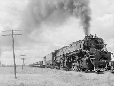 2018.15.N76.7915--ed wilkommen 3X4 neg--DM&IR--steam locomotive 2-8-8-4 M3 222 on train of ore empties--location unknown--1960 0700