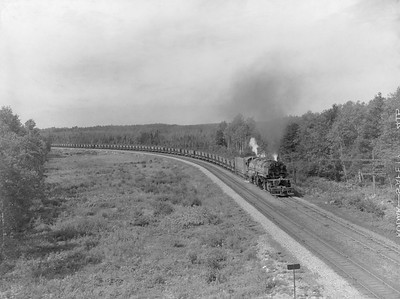 2018.15.N76.7911--ed wilkommen 3X4 neg--DM&IR--steam locomotive 2-8-8-4 M3 225 with train of ore loads action--location unknown--1960 0700