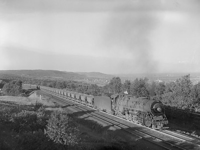 2018.15.N76.7902--ed wilkommen 3X4 neg--DM&IR--steam locomotive 2-10-4 E4 708 with train of ore empties action--near Duluth MN--1960 0700