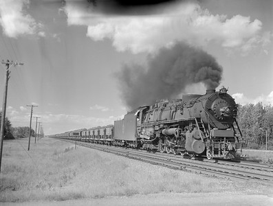 2018.15.N76.7896--ed wilkommen 3X4 neg--DM&IR--steam locomotive 2-10-4 E4 703 with train of ore loads action--location unknown--no date
