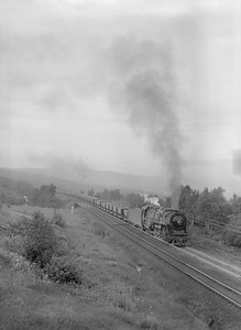 2018.15.N76.7904--ed wilkommen 3X4 neg--DM&IR--steam locomotive 2-10-4 E4 702 with train of ore empties action--near Duluth MN--1960 0700