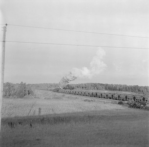 2018.15.N76.6087A--ed wilkommen 120 neg--DM&IR--steam locomotive 2-10-2 with empty ore cars in yard scene action--location unknown--no date