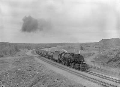 2018.15.N76.7909--ed wilkommen 3X4 neg--DM&IR--steam locomotive 2-8-8-2 M2S 211 with train of ore loads--location unknown--1960 0700