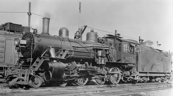 2018.15.L.6981M--ed wilkommen 5x7 COPY neg--CMStP&P--steam locomotive 4-6-0 G6ms 1170--location unknown--no date