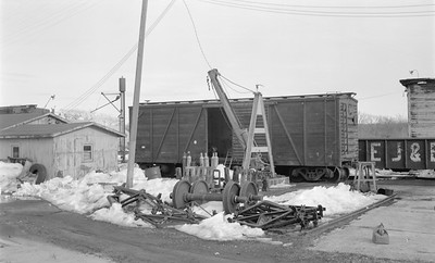 2018.15.N62.2117--ed wilkommen 116 neg--RIP track with CMStP&P wooden boxcar--location unknown--no date