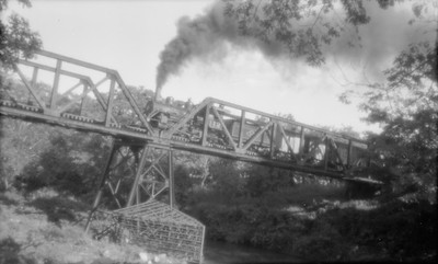 2018.15.N53B.1905--ed wilkommen 116 neg--FEGUA--mixed train on bridge action--Guatemala--1960s