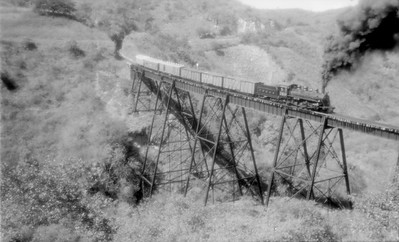 2018.15.N53A.1901--ed wilkommen 116 neg--FEGUA--mixed train on trestle action--Guatemala--1960s
