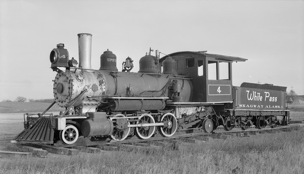 2018.15.N49N.7337--ed wilkommen 116 neg--WP&Y--steam locomotive 2-6-2 4 stored in cleared field near highway 41--Oakwood WI--1957 0307