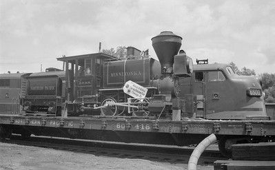 2018.15.N72.5636--ed wilkommen 116 neg--NP--steam locomotive 0-4-0 Minnetonka on display on flatcar--St Paul MN--1948 0623