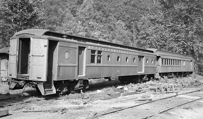 2018.15.N64E.8128--ed wilkommen 116 neg--Buffalo Creek & Gauley--baggage car and coach in storage--Dundon WV--no date