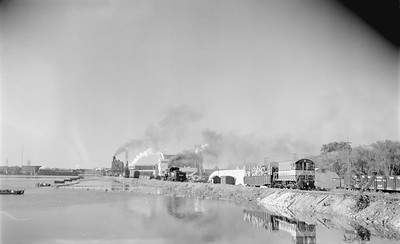 2018.15.N64.2586--ed wilkommen 116 neg--Consolidated Water Power & Paper--yard scene with steam locomotive 2-8-0 350 switching with GB&W diesel--Wisconsin Rapids WI--no date