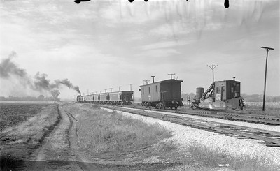 2018 15 N64 2614--ed wilkommen 116 neg--DRI&NW--steam locomotive 0-6-0 51 shoving work train action--near Pleasant Valley IA--1953 1031