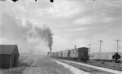 2018 15 N64 2613--ed wilkommen 116 neg--DRI&NW--steam locomotive 0-6-0 51 shoving work train action--near Pleasant Valley IA--1953 1031