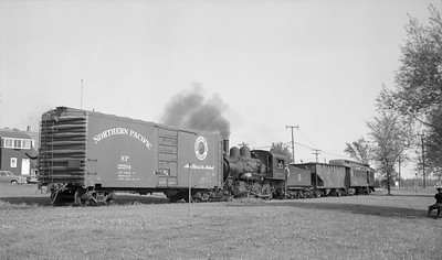 2018.15.N64C.7868--ed wilkommen 116 neg--EJ&S--steam locomotive 2-6-0 6 switching freight cars--Bellaire MI--no date