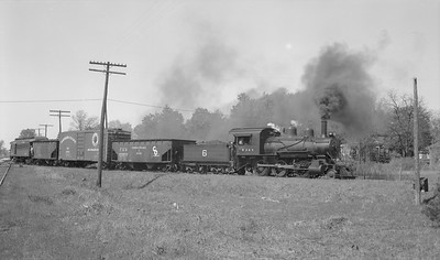 2018.15.N64C.7867--ed wilkommen 116 neg--EJ&S--steam locomotive 2-6-0 6 departing with mixed train--Bellaire MI--no date