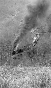 2018.15.N64C.2048--ed wilkommen 116 neg--Graham County--Shay steam locomotive 1928 on freight train action--near Robbinsville TN--no date