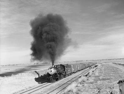 2018.15.N64D.8121--ed wilkommen 3x4 neg--Great Western--steam locomotive 2-10-0 90 on freight train action--location unknown--no date