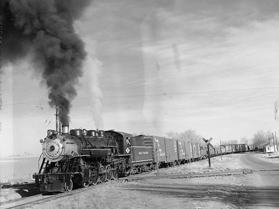 2018.15.N64D.8120--ed wilkommen 3x4 neg--Great Western--steam locomotive 2-10-0 90 on freight train action--location unknown--no date