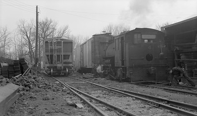 2018.15.N64B.7858--ed wilkommen 116 neg--Illinois Midland Railroad--steam locomotive 0-4-0T 4 in yard scene--Newark IL--no date