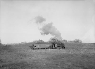 2018.15.N64B.7855--ed wilkommen 3x4 neg--Illinois Midland Railroad--steam locomotive 0-4-0T 4 with one-car freight train action--near Newark IL--no date