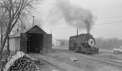 2018.15.N64B.7856--ed wilkommen 116 neg--Illinois Midland Railroad--steam locomotive 0-4-0T 4 at enginehouse--Newark IL--no date