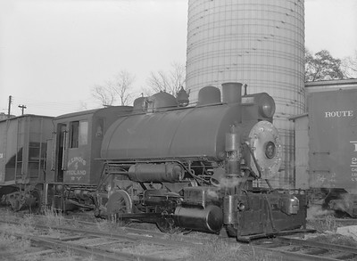 2018.15.N64B.7854--ed wilkommen 3x4 neg--Illinois Midland Railroad--steam locomotive 0-4-0T 4 in yard--Newark IL--no date