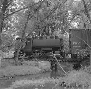 2018.15.N64B.7861--ed wilkommen 120 neg--Illinois Midland Railroad--steam locomotive 0-4-0T 4 with boxcar--near Newark IL--no date