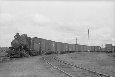 2018.15.N64.2814--ed wilkommen 6x9 neg--MT&W--steam locomotive 2-6-0 19 with freight cars in yard--Tomahawk WI--1952 0828