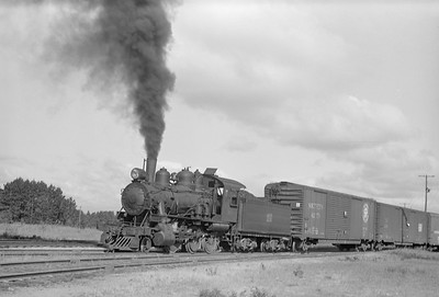 2018.15.N64.2818--ed wilkommen 6x9 neg--MT&W--steam locomotive 2-6-0 19 with freight cars in yard--Tomahawk WI--1952 0828