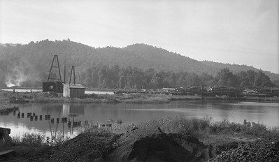 2018.15.N64L.8132--ed wilkommen 116 neg--log pond and logging cars scene--location unknown--no date